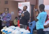 Cedric Babu sensitizing Kampala residents about the dangers COVID19 presents and best way to avoid the virus