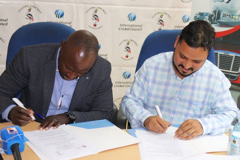 A Uganda Cricket official and Dr. Sharma of Victoria University signing the MoU recently