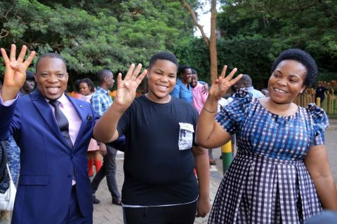 Minister Namuganza (R), in celebratory mood, is seen gesturing with Rwakabale upon receiving news that the son had performed well in his PLE.