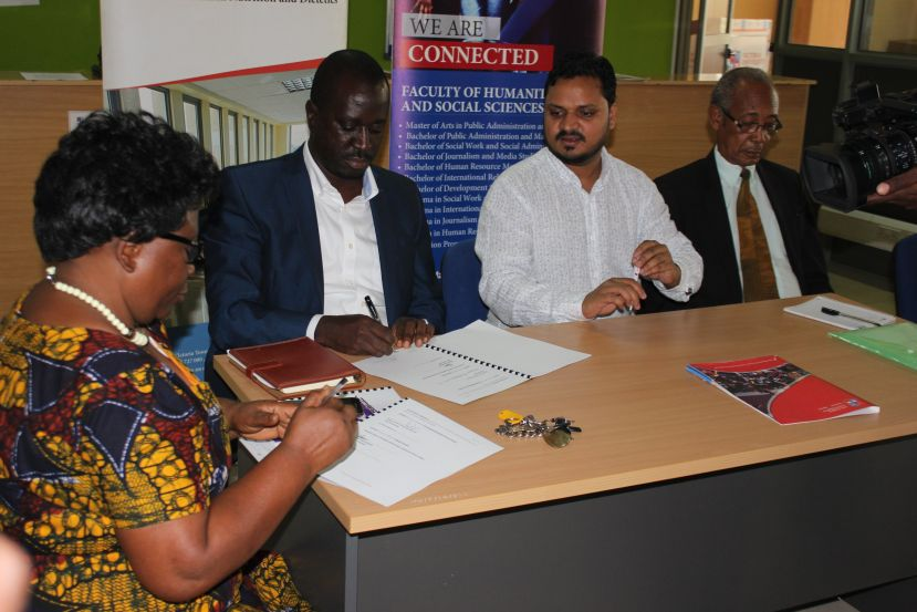 Victoria University and FUBA signing the MoU