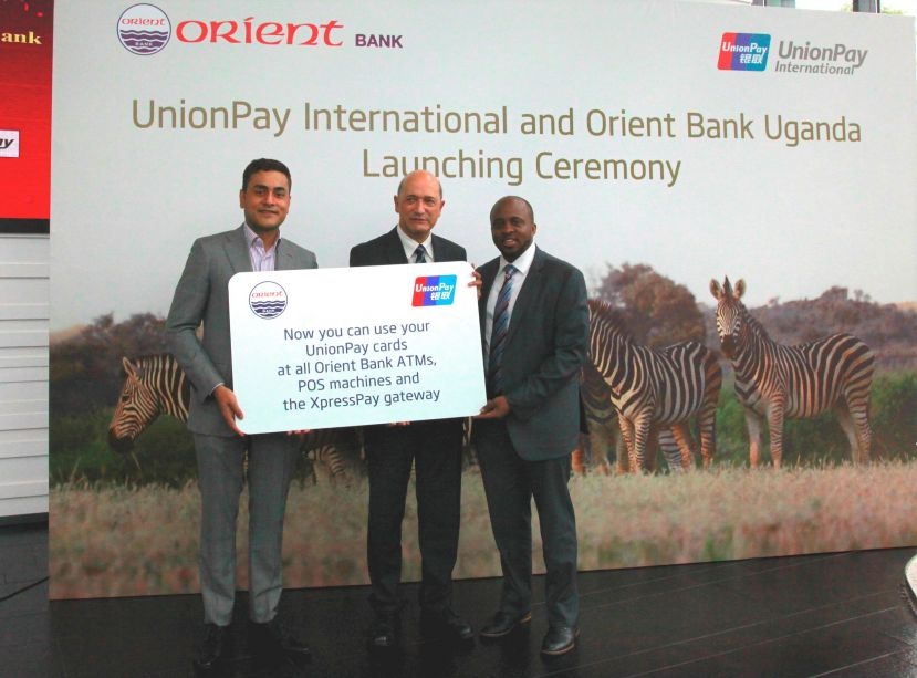 Mr. Tashin Morjaria (L),Orient Head of Business Development and Mr. Michael Nsereko (R ) Orient Head of e-banking join Mr. Shuan Ghaidan (C), UnionPay International Company Leader and Director of Products at the partnership launch at UnionPay Headquarters in Shanghai.