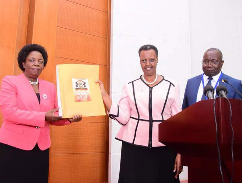 Minister of Education and Sports Janet Kataha Museveni recently receiving PLE results from a UNEB official