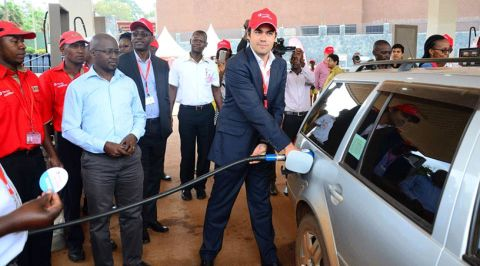 Total Uganda MD, Florentin de Loppinot  fueling a customer car at the launch of Excellium