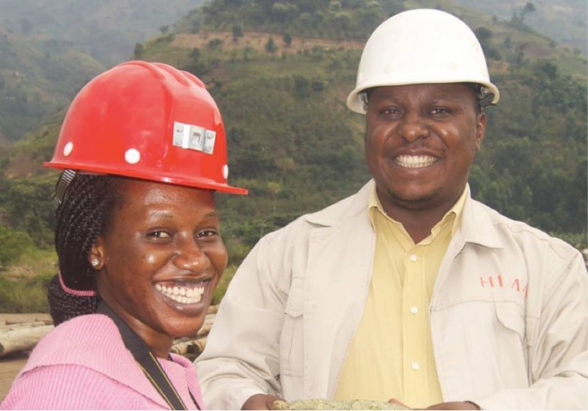 Flavia Nalubega and a colleague in the field